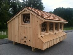Check out this AWESOME custom coop we're building... 8x12 with cedar shake roof, wooden barn sash tilt windows with chain(s), interior wire partition, Glasbord floor, wooden gable vents, Cleaner Coop Tray and electrical package. The windows will all get wire mesh before we deliver it. We also made a custom chicken run (with under coop panels) to go with this fabulous hen house.
