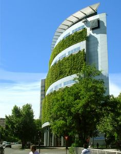 The Consorcio Building in Santiago de Chile, Chile is one of the world's most eco-friendly office complexes. It uses up to 48% less energy thanks to the vegetation climbing up its exterior walls, which turns red in autumn.