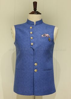 This simple and elegant waistcoat in blue color fabricated from xyz. It's a great festive wear featured with a mandarin collar, welted pockets and a unique button styling. Wedding Kurta For Men, Wedding Dress Men, Wedding Suits, Nigerian Men Fashion, Indian Men Fashion, Mens Fashion Suits, Waistcoat Designs, Mens Kurta Designs, Designer Suits For Men