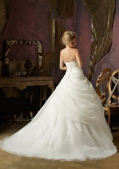 Beautiful. Think I'd like it off-white with no diamonds but it is gorgeous... Mori Lee 4973 Wedding Dress Corset back.