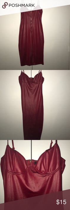 Ms Jackson Burgundy spaghetti strap dress. Very sexy , it has a split in the back. My go to for date night or night life plus cocktails. Size L 95% polyester . Also a made in slip for full coverage under dress. Dresses Midi