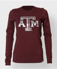 """This super soft maroon cotton longsleeve tee is made in the USA and features a bejewled block ATM on the front and a bejeweled """"Aggies"""" down..."""