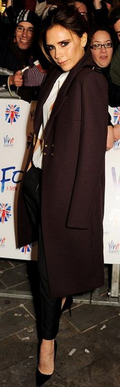 Who made Victoria Beckham's white button down top, black pumps, black pants, and red coat that she wore in London on December 11, 2012? Shirt, and coat – Victoria Beckham Collection  Pants – Isabel Marant  Shoes – Manolo Blahnik