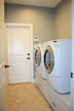 Put your front loading washer and dryer on a pedestal to to make them easier to use. Plus, drawers provide extra storage!