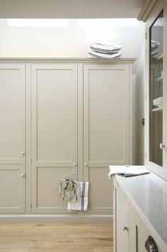 Beautiful and practical triple larder cupboards in the Kew Shaker Kitchen by deVOL.