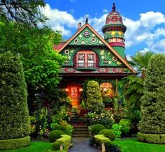 The garden's colorful palette was carefully chosen to complement the autumnal colors on the fanciful Queen Anne Victorian.