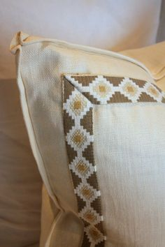 small flange with pinched corners and border trim on pillow