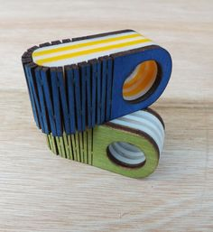 Wood and acrylic folded rings by Kathleen Smith