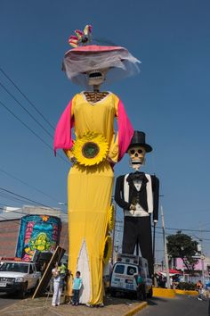 Large dressed skeletons greet visitors when arriving in San Andres de Mixquic