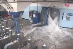 WABC-TV Flood waters rush in to the Hoboken PATH station through an elevator shaft.