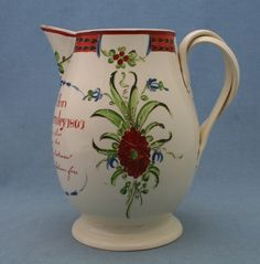"One of the tankards is decorated with the name ""William Clarebrough Kipax 1803"" (sic). It's marked with a red enamelled T to base. Kippax is a village now in the Parish of Leeds, approx 9 miles to the East of Hunslet. There is a pearlware jug also shown dated 1802 for a ""James Stevenson Aged 31 Kippax 1802"" Marked with a red enamelled T and LEEDS POTTERY."