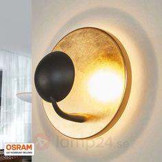 Extravagant LED-vägglampa Aurora svart-guld beställ säkert & bekvämt på Lamp24.se.