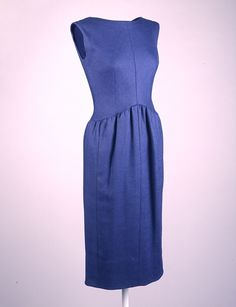 Designer: Norman Norell (American, 1900-1972) Place Made: USA Date Made: ca. 1960 Medium: Plain weave linen Dimensions: 27 in. center back Sleevless day dress in denim-blue linen with buttons down center back and pleated waist at front. This dress was worn by First Lady Jacqueline Kennedy for a visit to the Parthenon in Athens Greece on June 11, 1961.