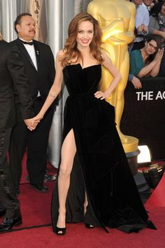 Pin for Later: 85 Unforgettable Looks From the Oscars Red Carpet Angelina Jolie at the 2012 Academy Awards Angelina Jolie showed off major red-carpet glamour in a black high-slit gown by Versace Atelier at the 2012 awards.