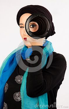 Young Woman Holding A Lens In Hijab And Colorful Scarf - Download From Over 35 Million High Quality Stock Photos, Images, Vectors. Sign up for FREE today. #Arabic #woman #highfashion #makeup #hijab #colorful #scarf #fashion #earrings #Arabian #Oriental #galleries #Turkish #Islamic #Egyptian #Burnette #Veil #African #Turban #AfricanWrap #Wrap #Portrait #Girl #Young #Women #Camera #Necklace #Hamsa #Photography #StockPhotography #Art #portfolio #Background #FashionPhotography #Lipstick…
