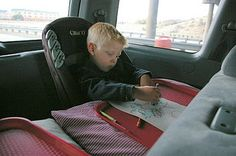 Serving tray hotglued to a pillowcase for road trips... raised edges on the tray make it so that crayons don't roll off.