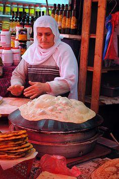 Druze Woman Making Bread   Carmel Market, Tel Aviv, Israel