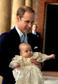 Prince William, Duke of Cambridge arrives, holding his son Prince George, at Chapel Royal in St James's Palace, ahead of the christening of the three month-old Prince George of Cambridge by the Archbishop of Canterbury on October 23, 2013 in London, England.