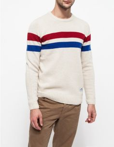 New from Penfield, a knitted crew neck sweatshirt crafted from a soft lambswool blend with two tone stripe patterning. Features contrast ribbed cuffs, neck, and hem for a neat and comfortable fit. • Lambswool blend sweater • Striped patterning •