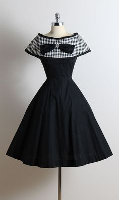 ➳ vintage 1950s dress  * black cotton * detachable gingham print cape * bow accent * full skirt * metal back zipper  condition | excellent