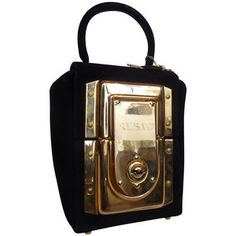 This 1960s padlock bag is not your traditional vintage. Full of alluring charm, this bag is one in a million. Designed in black suede, to not detract from its central feature, the golden metal padlock. The eminent feature is the centre of attraction in reflective gold, but no padlock with be complete without a key. Attached by a thin gold chain the matching key provides access and security. This captivating bag is by French luxury bag designer Jean Marlaix who started La Bagagerie in the…