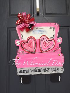 Valentines wreath valentines door hanger truck door hanger A truck full of love ❤️ full of whimsical charm, this door hanger is perfect for Valentines Day. Available in two bow options. Burlap or multicolored. Measures 22 wide x 24tall. Truck can be personalized, select yes from drop down menu and leave in comment section at Checkout. *****Order with confidence ****** Every order is handcrafted in my studio using quality supplies. The result is top quality products with satisfied custom...