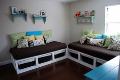 Make two toddler day beds/reading areas with crib mattresses.