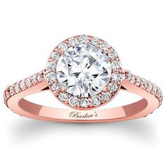Stunning in a rose gold halo setting, this beautiful ring makes for the perfect engagement ring this Valentines.