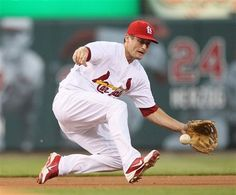 St. Louis Cardinals third baseman David Freese knocks down a ground-ball single by Pittsburgh's Pedro Alvarez during the second inning of a baseball game Wednesday, May 2, 2012, in St. Louis. (AP Photo/St. Louis Post-Dispatch, Chris Lee) EDWARDSVILLE OUT ALTON OUT