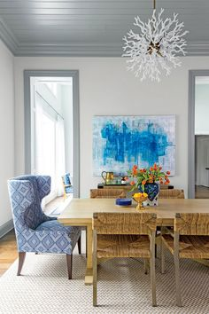 """Jazz up a matching diningset by adding wing chairsin indoor/outdoor fabric—Amazing Maze bySchumacher. A glass""""coral"""" chandelier andfearless painting seal theunconventional deal.    THE PALETTE  1. Light Gray: (walls)Alaskan Husky (1479)"""