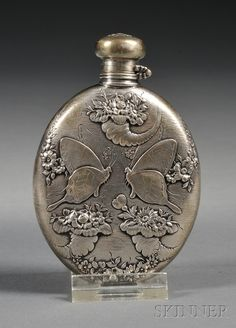 FLO's FLASK - Small Tiffany & Co. Sterling Flask, late century, oval, chased and embossed to front with a pair of butterflies amidst flower-filled cornucopia and floral swags, the reverse with two further butterflies and engraved monogram Antique Perfume Bottles, Vintage Bottles, Vintage Perfume, Vintage Silver, Antique Silver, Beautiful Perfume, Kugel, Or Antique, Flask