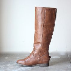 These gorgeous tan boots will go with everything! The neutral colors, the back zipper detailing, the rustic buckle-straps, these stylish riding boots will becom