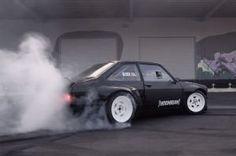 Watch Ken Block's New Gymkhana Ford Escort Vaporize its Rear Tires. The Hoonigan returns.