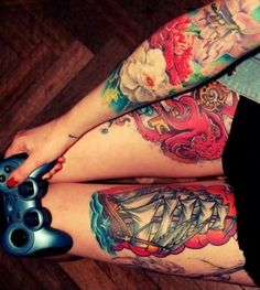 Tattooed gamer girl. Flower sleeve, octopus tattoo on the right leg and ship tattoo on the left leg. #tattoo #tattoos #ink #inked