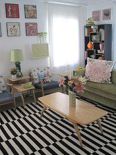 striped black and white rug. green sofa