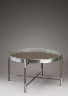 """""""At Bottega Veneta, Maier designs men's and women's ready-to-wear clothing, along with housewares, furniture, watches, porcelain and jewelry. In everything he designs, Maier shows an acute sensitivity to those infinitesimal irritants wich most people can overlook"""" - JOHN COLAPINTO - (""""Low Tray Table"""" by Bottega Veneta home collection. Materials: Vintage leather top and gunmetal structure with 'intrecciato' details)"""
