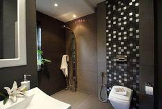 Modern Luxury Bathroom featuring clean design lines and powerful jet spraying shower column.