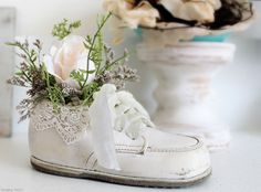 "Better than bronzed!  ~  The blogger created a very sweet and sentimental piece with a baby shoe by adding a lace ""cuff"" and preserved flowers.  from shabbystory"