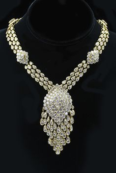 """Van Cleef and Arpels Necklace  This 18 karat yellow gold & diamond necklace by Van Cleef and Arpels exemplifies the style of the 60""""s decade.  Pieces of this caliber are often designed to be used multiple ways. The necklace is comprised of smaller elements that make the piece more versatile. For example, the pendant can be detached and worn on a different chain or as a brooch.  With over 90 carats of diamonds, the piece is a reminder of the 1960's unabashed embrace of glamour."""
