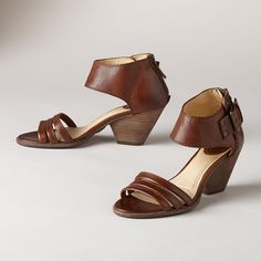 "REINA SANDALS -- A pair of high-heel leather sandals from Frye®, fit for a queen, with the understated, classic look you love. Stable, wide, canted heels. Imported. Whole and half sizes 6 to 10, 11. 2-1/2"" heel."