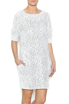 Printed dress with 3/4 sleeves, scoop neckline, two front pockets and a partial zipper back closure.    Gold White Pocket Dress by NU New York. Clothing - Dresses - Casual Clothing - Dresses - Printed Clothing - Dresses - Short Sleeve Manhattan, New York City
