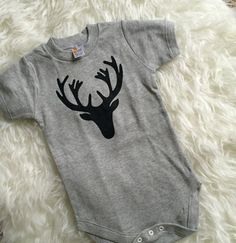 All Onesies are 100% Handmade and screen printed by Shop Aria. We sell baby onesies or toddler tees. This design Oh Deer Woodland Onesie is Unisex. All