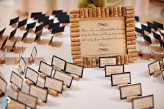 wine corks for a wedding: as name place card holders and as table number frames