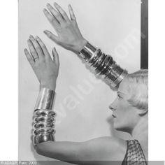 Man Ray portrait of Suzy Solidor wearing Chanel bracelets, 1920s.