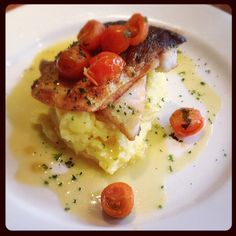 Pan-fried sea bass with saffron mashed potatoes and Sardinian-style tomatoes from Alghero
