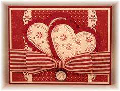 handmade Valentine from The Craft's Meow: Ribbon Tying Tutorial   ...pretty striped bow with the knot stripes vertical .. monochromatic ... two different patterned papers ... lovely!!