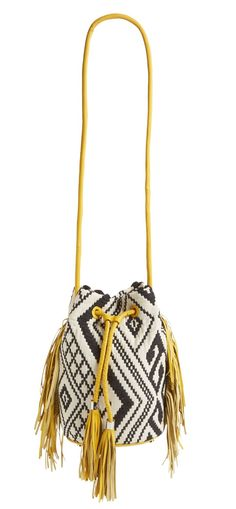 Carry festival essentials in this adorable bucket bag from Sam Edelman. It features colorful tassels and a contrasting geometric pattern.