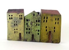 set of 3 ceramic houses in a row , made in high fired stoneware clay, painted with acrylic colors