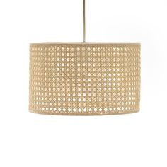 Dolkie rattan lamp shade. Compatible with ceiling pendants or freestanding lamps, it's the perfect way to add a natural touch to contemporary interiors.Product Details: •  Cylindrical shape.  •  Rattan cane.  •  Suitable for ceiling pendants or freestanding lamps.  •  Supports E27 bulb (not supplied). •  Non-electrified. •  Electrical system sold separately.  •  Search for the Baulind cable online.Find the full Dolkie collection online.Dimensions: •  Diameter 40cm •  Height 20 cm