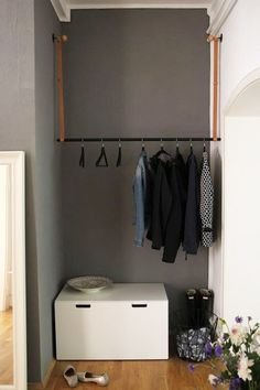 Hanging coat rack & white bench/box